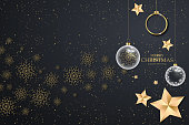 Black christmas background with golden snowflakes. Festive Christmas background with balls, stars
