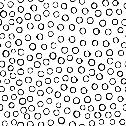 Black circles are arranged in random order with a void inside on an isolated background.