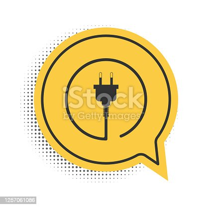 istock Black Electric plug icon isolated on white background. Concept of connection and disconnection of the electricity. Yellow speech bubble symbol. Vector 1257061086