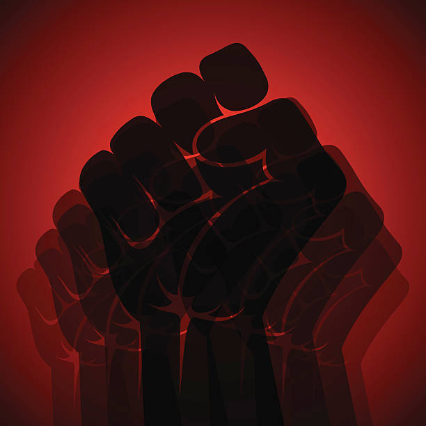 black fist on a red background to imply unity - black power stock illustrations