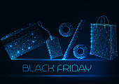 Futuristic black Friday sale concept with glowing low polygonal paper shopping bag, price tag, percentage sign and credit card on dark blue background. Modern wire frame design vector illustration.