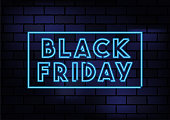 Black Friday Sign Blue Neon Light On Dark Brick Wall. Horizontal composition with copy space.