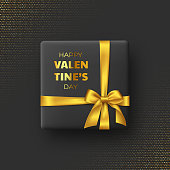 3d gift box with silk bow and ribbon on black glitter spotted background. Decorative love concept for Valentines day. Vector illustration.