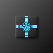 Black gift box with glittering blue bow and ribbon