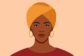 istock Black girl is wearing a yellow turban. African female with a scarf on her head. 1271785320