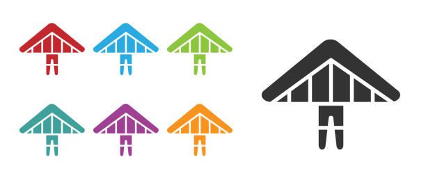 ilustrações, clipart, desenhos animados e ícones de ícone do planador black hang isolado no fundo branco. esporte extremo. defina ícones coloridos. ilustração vetorial - ícones de design planar