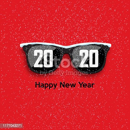 Black hipster glasses on snowfall background. 2020 Happy New Year and Merry Christmas.