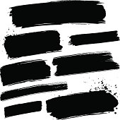 Various black grunge paint brush strokes on a white background.