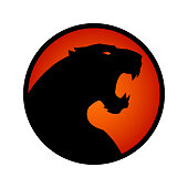 Angry black panther, leopard or jaguar with open mouth - vector silhouette in circle