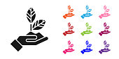 Black Plant in hand of environmental protection icon isolated on white background. Seed and seedling. Planting sapling. Ecology concept. Set icons colorful. Vector Illustration