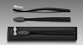 Black plastic toothbrush with package box