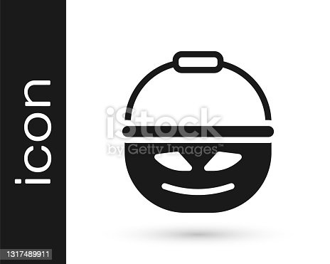 istock Black Pumpkin basket for sweets icon isolated on white background. Happy Halloween party. Vector 1317489911