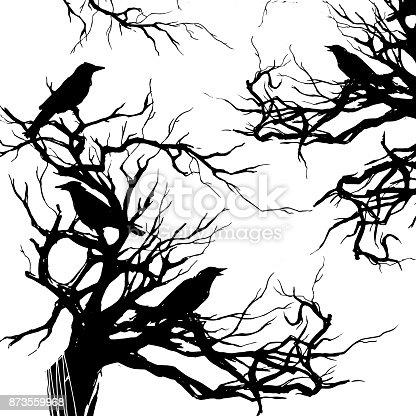 istock Black ravens on the old tree 873559968