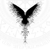 Black grunge bird silhouette with viking symbol on white background