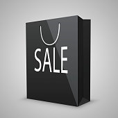 Black shopping bags with written sale
