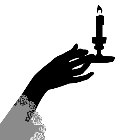 Black silhouette of female hand holding a candlestick with burning candle