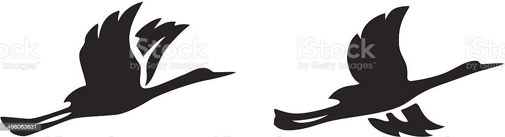 black silhouettes of flying birds - vector vector art illustration
