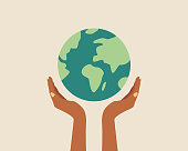 istock Black skin hands holding globe, earth. Earth day concept. Earth day vector illustration for poster, banner,print,web. Saving the planet,environment.Modern cartoon flat style illustration 1305636257