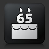 Black Square Button with 65 Years Birthday Cake. This royalty free vector image features a white interface icon on square black button. The vector button has a bevel effect and a light shadow. The image background is dark grey and the button has a light reflection.