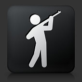 Black Square Button with Man Shooting a  Rifle Icon. This royalty free vector image features a white interface icon on square black button. The vector button has a bevel effect and a light shadow. The image background is dark grey and the button has a light reflection.