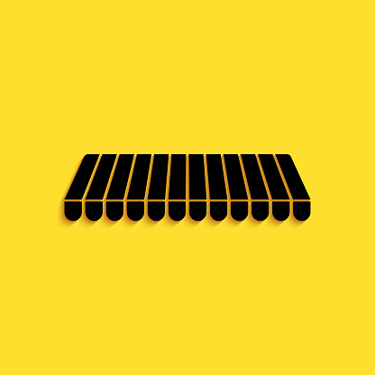 Black Striped awning icon isolated on yellow background. Outdoor sunshade sign. Awning canopy for shops, cafes and street restaurants. Long shadow style. Vector