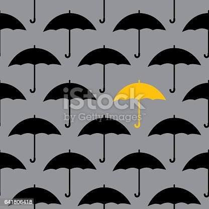 Vector seamless pattern of many black umbrellas and one yellow umbrella on a gray background.