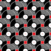 Vector seamless pattern of black vinyl records on a red background.