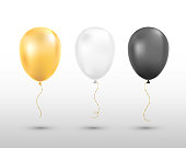 Black, white and golden balloons isolated. Vector illustration.