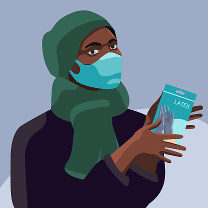 Black woman with medical gloves on grey backdrop