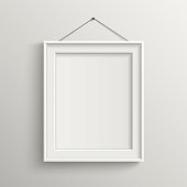blank frame on white wall with shadow