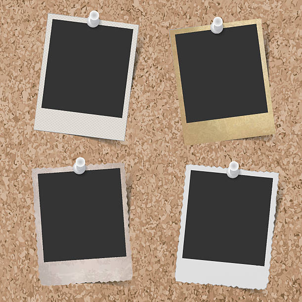 stockillustraties, clipart, cartoons en iconen met blank instant photo frames pinned to cork board background - kurk