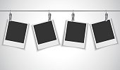 Blank photo frame hanging on wire rope with clip
