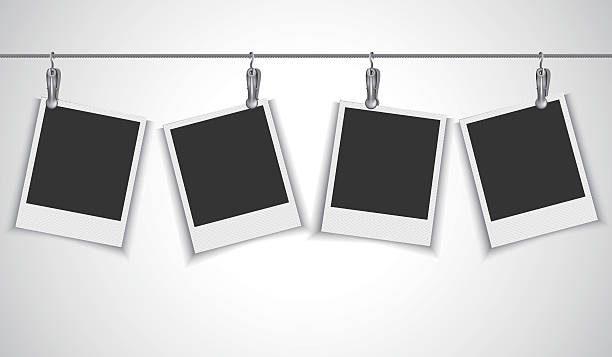 Blank photo frame hanging on wire rope with clip Vector EPS 10 format. polaroid frame stock illustrations