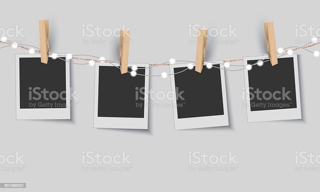 Blank photo frames with fairy lights vector art illustration
