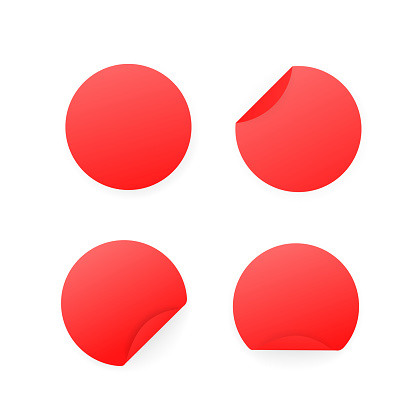 Blank red paper circle stickers isolated on white background