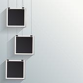 Blank retro vintage photo frames on a wall