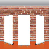 Blank vector roll up banners display mockup. Red brick wall.