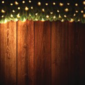 Blank Wooden background with bright Christmas garland