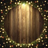 Blank wooden wall with bright Christmas wreath.