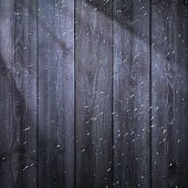 Blank wooden background and falling snow.