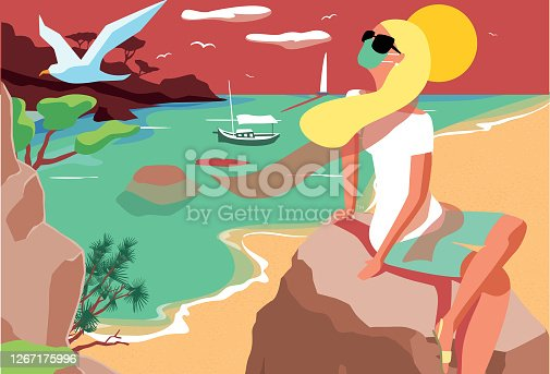 istock Blond woman watching sunset at sea 1267175996