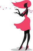 The silhouette of a girl in a halter dress blowing kisses (small hearts) from her hands with a shadow the shape of a heart beneath her.