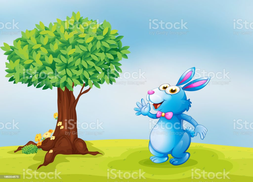 blue bunny waving in front of a big tree