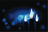 Blue candles with defocused lights