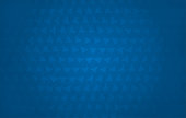 Dark blue coloured half tone vector background illustration with a pattern of tiny abstract triangles all over the frame.