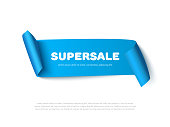 Blue curved paper ribbon banner with rolls and inscription SUPERSALE