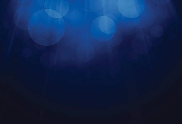 Blue Glow Background Blue glow defocused light background.  dark blue stock illustrations