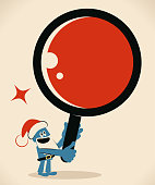 Blue Little Guy Characters Vector art illustration.Copy Space. Blue man with santa hat and beard holding a huge magnifying glass.