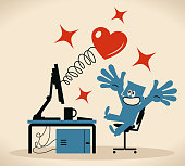 istock Blue man working on a computer and a heart symbol (love) comes out of the monitor 1203317078