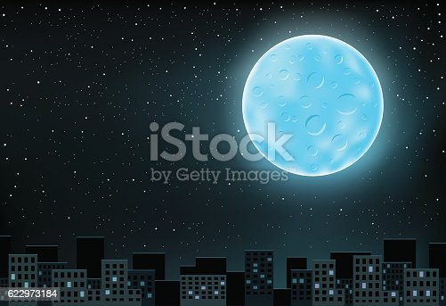 The large blue shining moon over night city on stars background